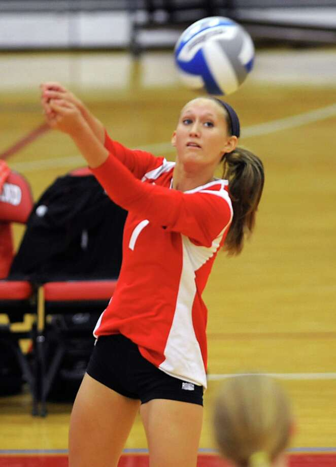 Guilderland's Rebecca Straubel hits the ball over the net during a volleyball match against Shenendehowa Thursday, Sept. 13, 2012 in Guilderland, N.Y. (Lori Van Buren / Times Union) Photo: Lori Van Buren