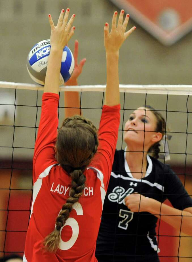 Guilderland's Kayla Myers, left, tries to block Shenendehowa's Gabby Agresta during a volleyball match Thursday, Sept. 13, 2012 in Guilderland, N.Y. (Lori Van Buren / Times Union) Photo: Lori Van Buren