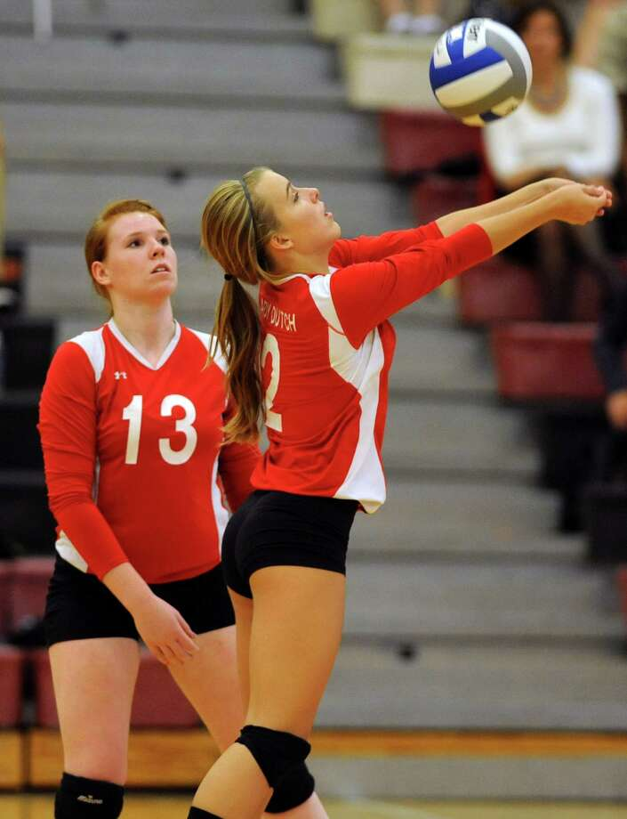 Guilderland's Jessica VanDoren hits the ball over the net during a volleyball match against Shenendehowa Thursday, Sept. 13, 2012 in Guilderland, N.Y. Quincy Kinzel stands by on left. (Lori Van Buren / Times Union) Photo: Lori Van Buren