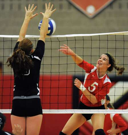 Guilderland's Allison VanDoren tries spike one past Shenendehowa's Hayley Macken during a volleyball match Thursday, Sept. 13, 2012 in Guilderland, N.Y. (Lori Van Buren / Times Union) Photo: Lori Van Buren