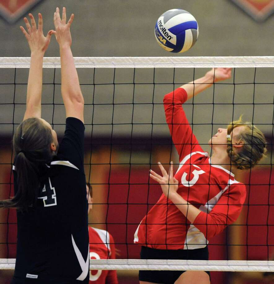 Shenendehowa's Taylor Murphy, left, tries to block Guilderland's Taylor Litwin during a volleyball match Thursday, Sept. 13, 2012 in Guilderland, N.Y. (Lori Van Buren / Times Union) Photo: Lori Van Buren