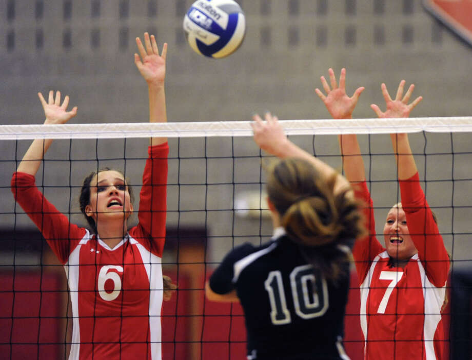 Guilderland's Kayla Myers, left, and Rebecca Straubel jump up to return the ball hit by Shenendehowa's Lauren Canterbury during a volleyball match Thursday, Sept. 13, 2012 in Guilderland, N.Y. (Lori Van Buren / Times Union) Photo: Lori Van Buren
