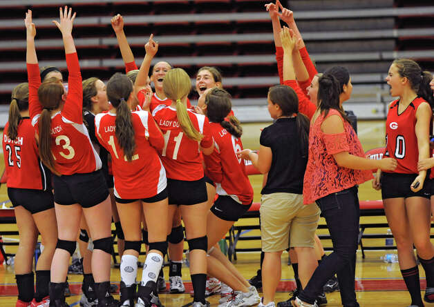 The Guilderland girl's volleyball team celebrates after winning in a match against Shenendehowa Thursday, Sept. 13, 2012 in Guilderland, N.Y. (Lori Van Buren / Times Union) Photo: Lori Van Buren