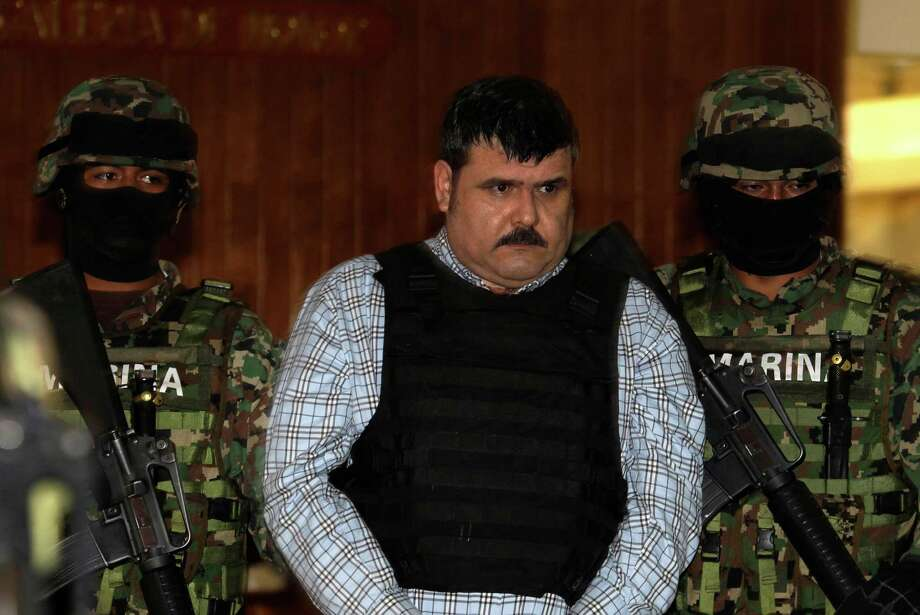 "Mexican marines escort Jorge Eduardo Costilla Sanchez, aka ""El Coss,"" as he is shown to the press in Mexico City on Wednesday. Photo: Dario Lopez-Mills / AP"