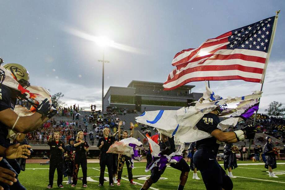 Westfield 40, Klein Collins 19Klein Collins fullback Brandon Edmonds carries the American flag as he leads his team onto the field to face Westfield in a high school football game at at Klein Memorial Stadium on Thursday, Sept. 13, 2012, in Houston. Photo: Smiley N. Pool, Houston Chronicle / © 2012  Houston Chronicle