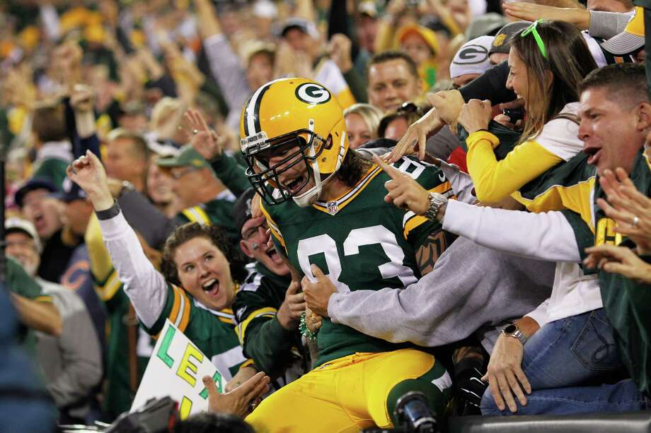"""The Packers' Tom Crabtree does the """"Lambeau Leap"""" after scoring a 27-yard touchdown reception that came off a fake field-goal attempt in the first half. Photo: Joe Robbins, Getty Images / 2012 Getty Images"""