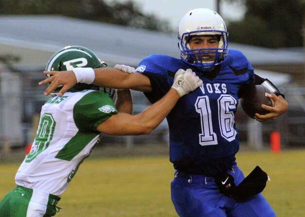 Lanier quarterback Nick Garcia stiff arms Tyler Popham of Pleasanton during high-school football action at the Spring Sports Complex on Thursday, Sept. 13, 2012. Photo: Billy Calzada, Express-News / © San Antonio Express-News