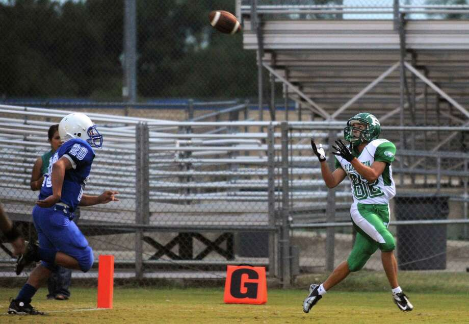 Pleasanton receiver Zade Llamas catches a touchdown pass as Joe Orta of Lanier chases during high-school football action at the Spring Sports Complex on Thursday, Sept. 13, 2012. Photo: Billy Calzada, Express-News / © San Antonio Express-News