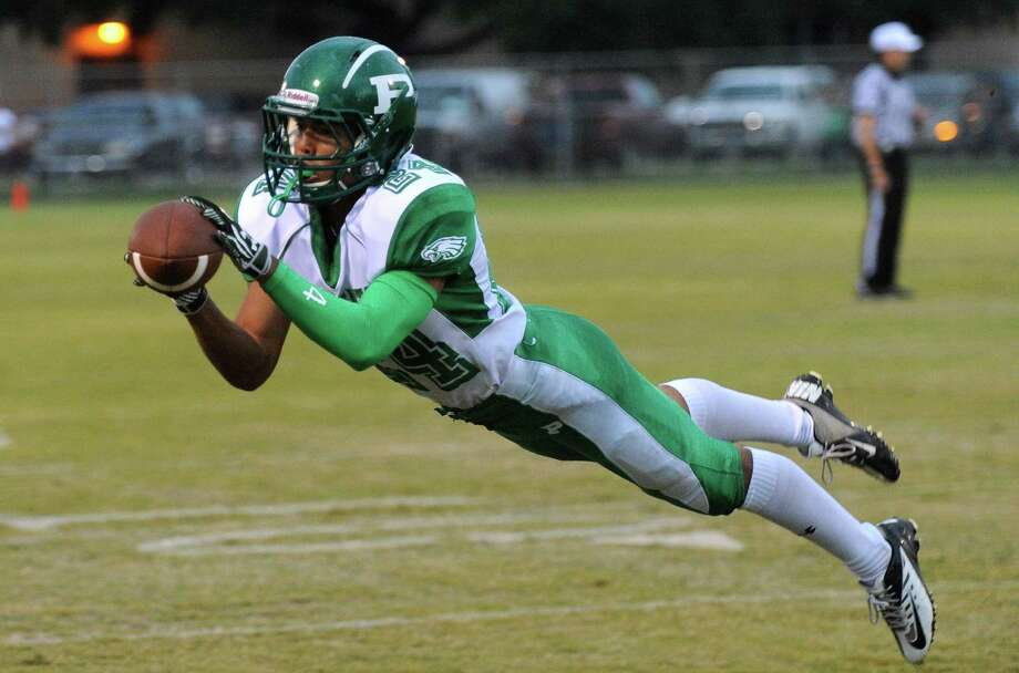 Pleasanton receiver Mike Sorola is unable to hold on to a potential touchdown pass during high-school football action against Lanier at the Spring Sports Complex on Thursday, Sept. 13, 2012. Photo: Billy Calzada, Express-News / © San Antonio Express-News