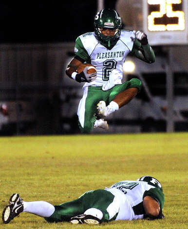 Pleasanton running back Jacob Arevalo jumps over blocker Felipe Olivarri as he runs for yardage against Lanier during high-school football action at the Spring Sports Complex on Thursday, Sept. 13, 2012. Photo: Billy Calzada, Express-News / © San Antonio Express-News