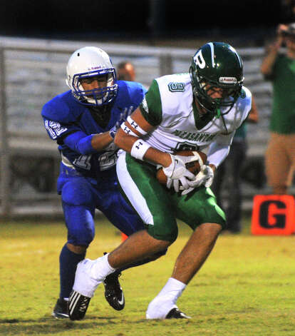 Pleasanton receiver Jake Mickaels catches a touchdown pass as Hector DeHoyos of Lanier defends during high-school football action at the Spring Sports Complex on Thursday, Sept. 13, 2012. Photo: Billy Calzada, Express-News / © San Antonio Express-News