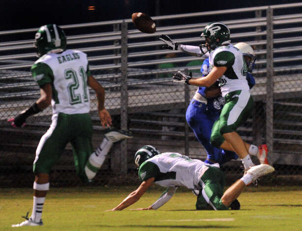 Linebacker Luke Stewart of Pleasanton (45) knocks the ball away from receiver Ajax Reyes of Lanier during high-school football action at the Spring Sports Complex on Thursday, Sept. 13, 2012. Photo: Billy Calzada, Express-News / © San Antonio Express-News