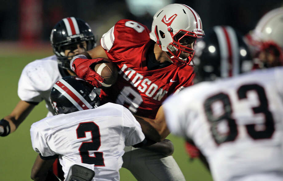 Rocket wide receiver Jermaine Adams battles a pack of tacklers as Judson hosts Churchill at Rutledge Stadium on September 13, 2012. Photo: Tom Reel, Express-News / ©2012 San Antono Express-News