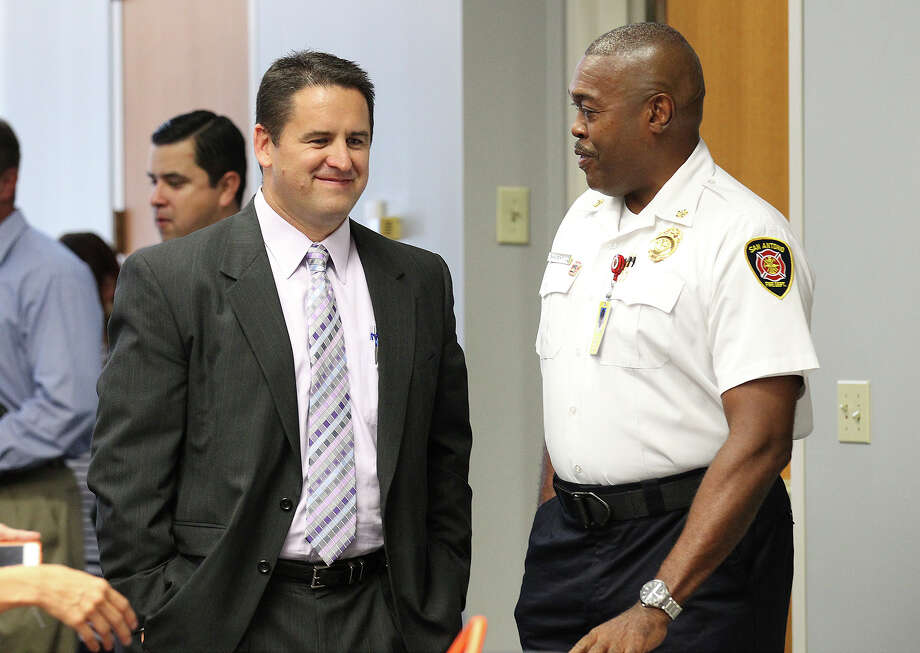 Assistant City Manager Erik Walsh (left) and San Antonio Fire Department Chief Charles Hood chat before a meeting by the city council, the fire department and police department to discuss the proposed budgets for 2014 at Municipal Plaza on Tuesday, Aug. 13, 2013. Photo: Kin Man Hui, San Antonio Express-News / ©2013 San Antonio Express-News