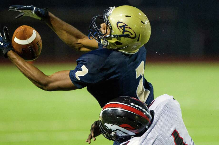 Klein Collins receiver Jordan Thomas (2) makes a catch as Westfield's Brian Peavy (4) defends during the first half of a high school football game at at Klein Memorial Stadium on Thursday, Sept. 13, 2012, in Houston. Photo: Smiley N. Pool, Houston Chronicle / © 2012  Houston Chronicle