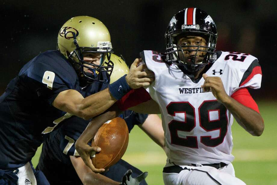 Klein Collins quarterback Blake Jackson (9) tries to make the tackle as Westfield safety Ron Knowles (29) returns an intercepted pass during the first half of a high school football game at at Klein Memorial Stadium on Thursday, Sept. 13, 2012, in Houston. Photo: Smiley N. Pool, Houston Chronicle / © 2012  Houston Chronicle