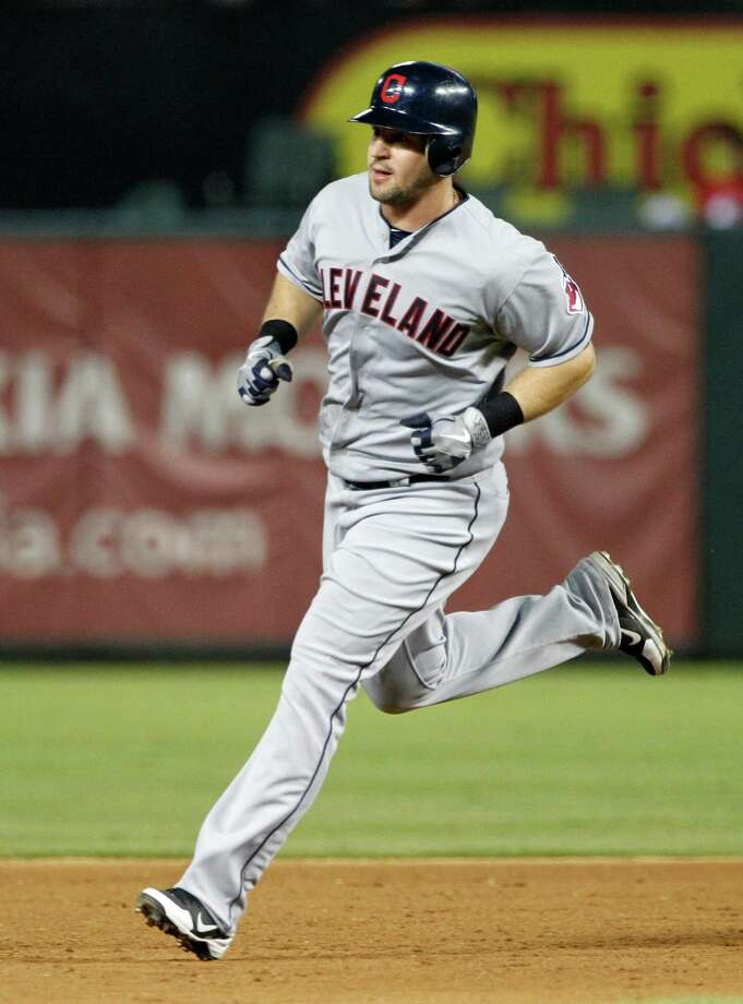 Cleveland Indians' Matt LaPorta cricles the bases after hitting a two-run home run off Texas Rangers' Derek Holland in the sxith inning of a baseball game on Thursday, Sept. 13, 2012, in Arlington, Texas. The shot also scored Vinny Rottino. Photo: Tony Gutierrez