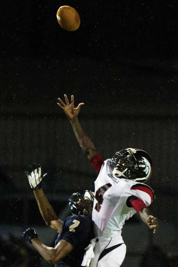 Westfield defensive back Brian Peavy (4) breaks up a pass intended for Klein Collins reciever Jordan Thomas (2) during the first half of a high school football game at at Klein Memorial Stadium on Thursday, Sept. 13, 2012, in Houston. Photo: Smiley N. Pool, Houston Chronicle / © 2012  Houston Chronicle