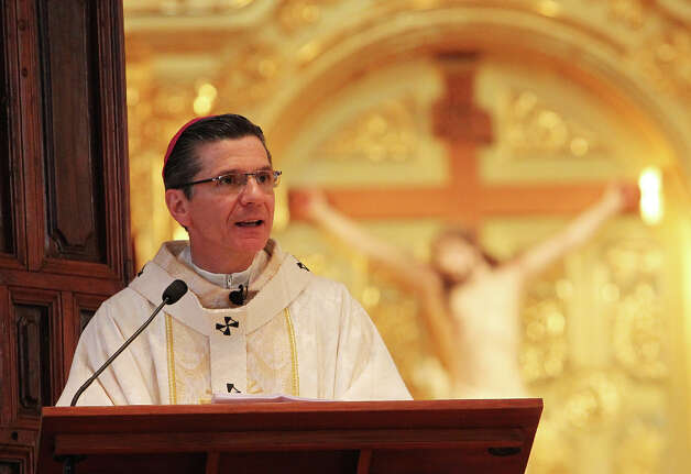 Archbishop Gustavo Garcia-Siller speaks to congregants at a Mass at San Fernando Cathedral on Thursday, Sept. 13, 2012. Archbishop Garcia-Siller presided over the ceremony that marked the 25th anniversary of the visit to San Antonio by Pope John Paul, II. Photo: Kin Man Hui, SAN ANTONIO EXPRESS-NEWS / ©2012 San Antonio Express-News