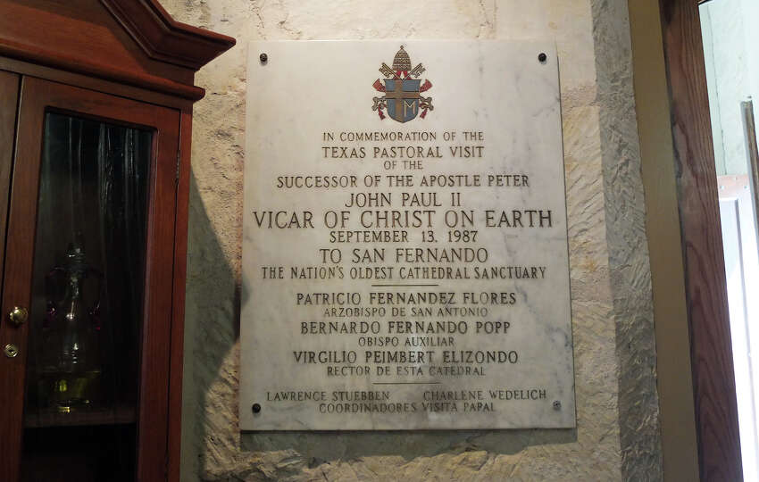 A plaque hangs on the wall of San Fernando Cathedral marking the visit to San Antonio of Pope Joh