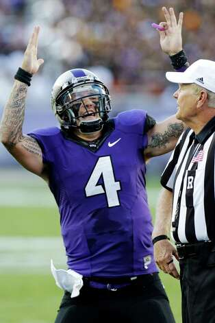 TCU quarterback Casey Pachall (4) celebrates a touchdown during the first half of an NCAA college football game against Grambling State in Fort Worth, Texas, Saturday, Sept. 8, 2012. (AP Photo/LM Otero) Photo: LM Otero, Associated Press / AP