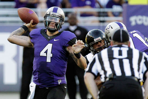 TCU quarterback Casey Pachall (4) throws during the first half of an NCAA college football game against Grambling State in Fort Worth, Texas, Saturday, Sept. 8, 2012. (AP Photo/LM Otero) Photo: LM Otero, Associated Press / AP