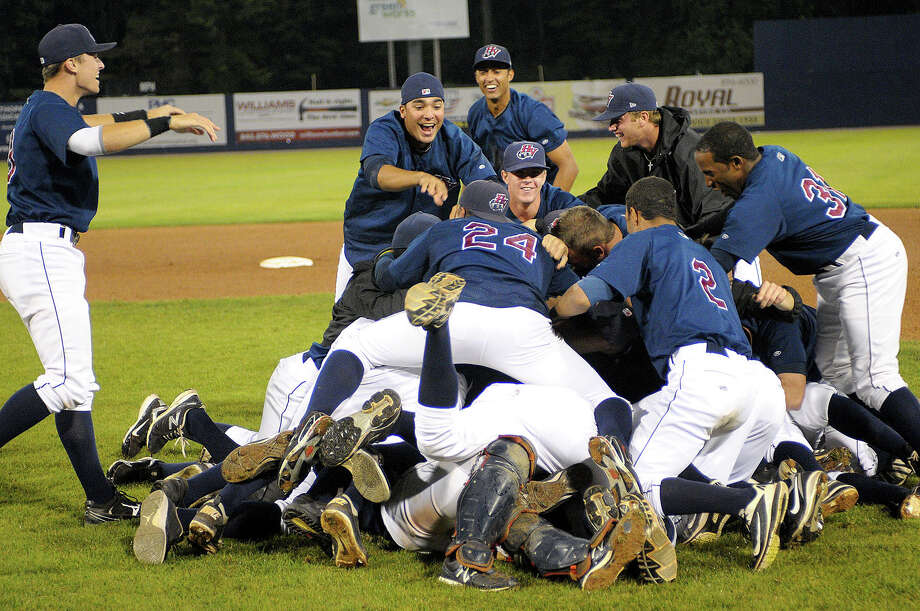The Hudson Valley Reganades defeated the Tri City ValleyCats 8-3 to take the New York- Penn League Championship. Players pile on after the third out in the ninth inning to celebrate. Photo: David W Doonan / ©2012 David W Doonan