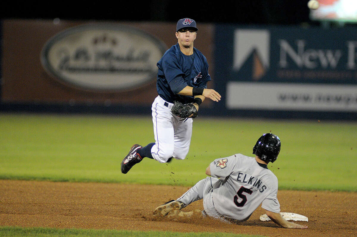The Hudson Valley Reganades defeated the Tri City ValleyCats 8-3 to take the New York- Penn League Championship. Valley Cat second baseman Austin Evans (#5), slides into second in an attempt to break up the double play.