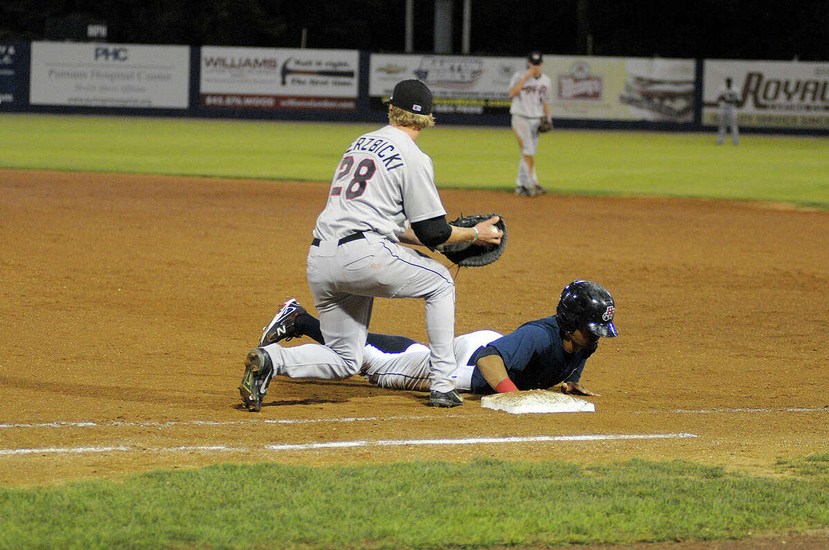 The Hudson Valley Reganades defeated the Tri City ValleyCats 8-3 to take the New York- Penn League Championship. First baseman Jesse Wierzbicki (#28) keeps a Renagades runner close.