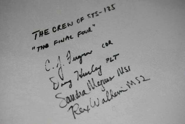 The signatures of the last crew of Space Shuttle astronauts are shown as work continues to assemble the Space Shuttle Full Fuselage Trainer on Thursday, September 13 ,2012 at Seattle's Museum of Flight. Workers are busy preparing the trainer for its public debut, scheduled for Nov. 10, as the centerpiece of the museum's new Charles Simonyi Space Gallery. Photo: JOSHUA TRUJILLO / SEATTLEPI.COM