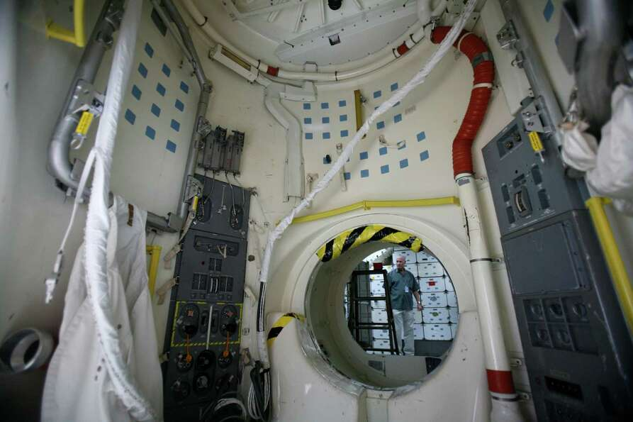 The air lock is shown as work continues to assemble the Space Shuttle Full Fuselage Trainer on Thurs