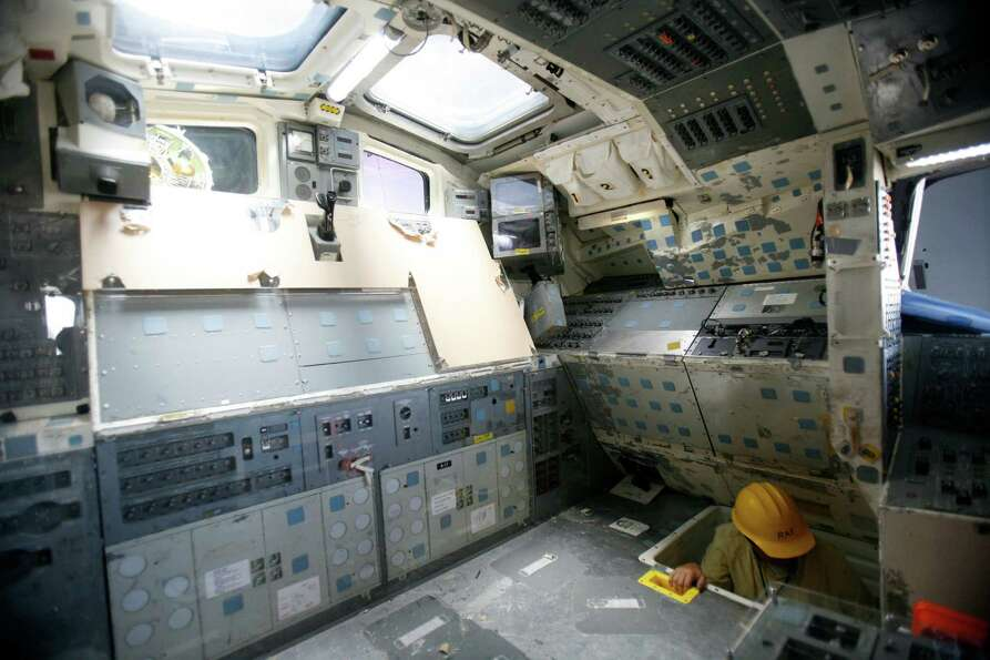 The flight deck is shown as work continues to assemble the Space Shuttle Full Fuselage Trainer on Th