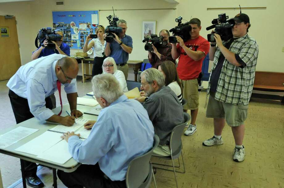 Albany County District Attorney David Soares signs in to vote in the primary  at Community United Methodist Church on Thursday Sept. 13, 2012 in Slingerlands, N.Y.   (Philip Kamrass / Times Union) Photo: Philip Kamrass / 00019250B
