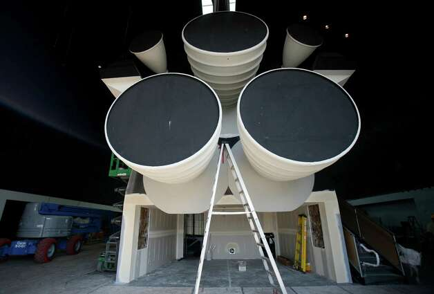 The engine bells are shown as work continues to assemble the Space Shuttle Full Fuselage Trainer on Thursday, September 13 ,2012 at Seattle's Museum of Flight. Workers are busy preparing the trainer for its public debut, scheduled for Nov. 10, as the centerpiece of the museum's new Charles Simonyi Space Gallery. Photo: JOSHUA TRUJILLO / SEATTLEPI.COM