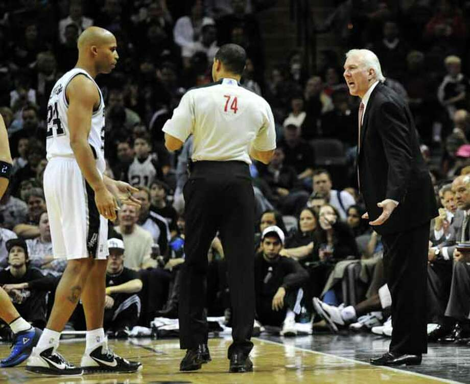 San Antonio Spurs head coach Greg Popovich and San Antonio Spurs small forward Richard Jefferson (24) argue a call with NBA official Curtis Blair during a NBA basketball game between the San Antonio Spurs and the Dallas Mavericks at the AT&T Center in San Antonio, Texas on November 26, 2010 John Albright / Special to the Express-News. (John Albright / For the Express-News) Photo: JOHN ALBRIGHT, San Antonio Express-News / San Antonio Express-News