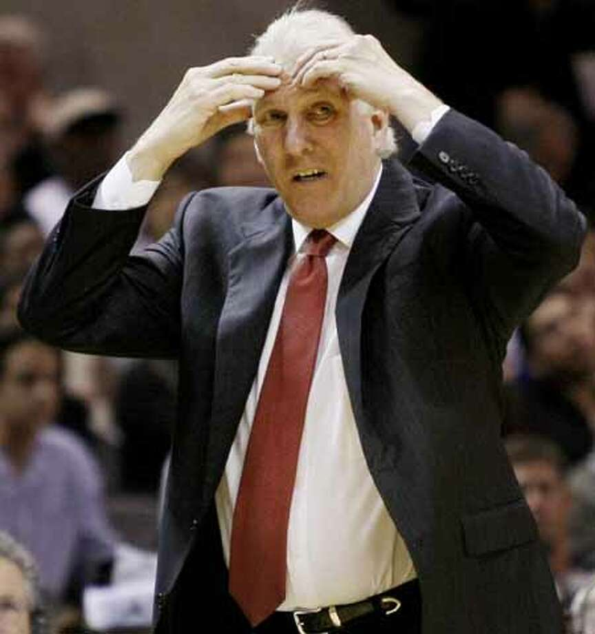 San Antonio Spurs head coach Gregg Popovich reacts during the second half of an NBA basketball game against the Denver Nuggets, Wednesday, Dec. 22, 2010, in San Antonio. San Antonio won 109-103. Photo: AP