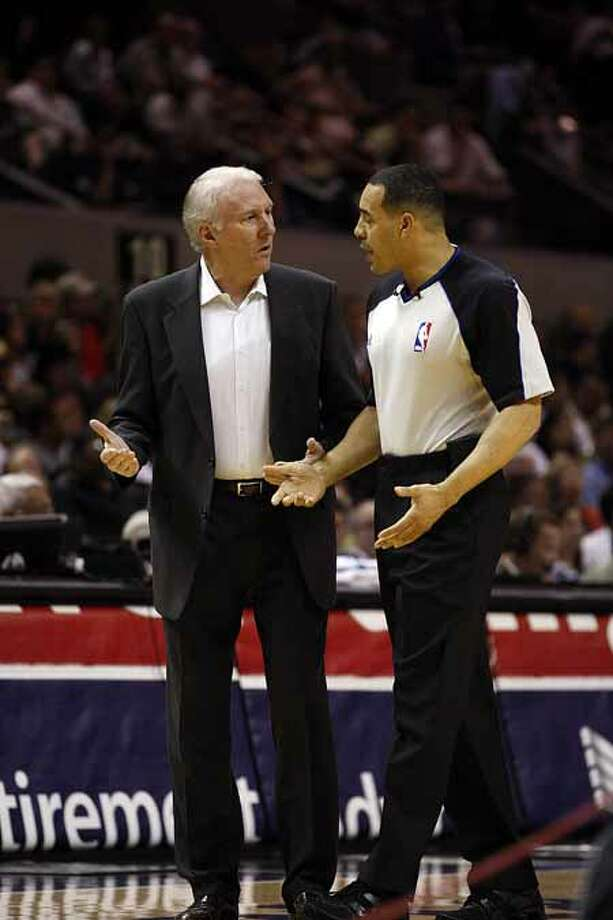 SPURS -- San Antonio Spurs Head Coach Gregg Popovich discusses a call with Official Curtis Blair in the first half against the Sacramento Kings at the AT&T Center, Wednesday, April 6, 2011. JERRY LARA/glara@express-news.net Photo: JERRY LARA, San Antonio Express-News / SAN ANTONIO EXPRESS-NEWS (NFS)