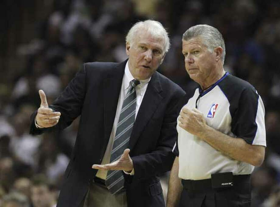 San Antonio coach Gregg Popovich talks to official Bob Delaney in Game 5 of the first round of the Western Conference playoff at the AT&T Center on Wednesday, April 27, 2011. Kin Man Hui/kmhui@express-news.net Photo: KIN MAN HUI, SAN ANTONIO EXPRESS-NEWS / San Antonio Express-News NFS