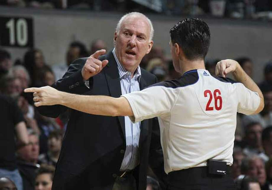 SPURS -- San Antonio Spurs Head Coach Gregg Popovich talks with official Pat Fraher during the first half against the Atlanta Hawks at the AT&T Center, Wednesday, Jan. 25, 2012. Jerry Lara/San Antonio Express-News Photo: Jerry Lara, San Antonio Express-News / © San Antonio Express-News