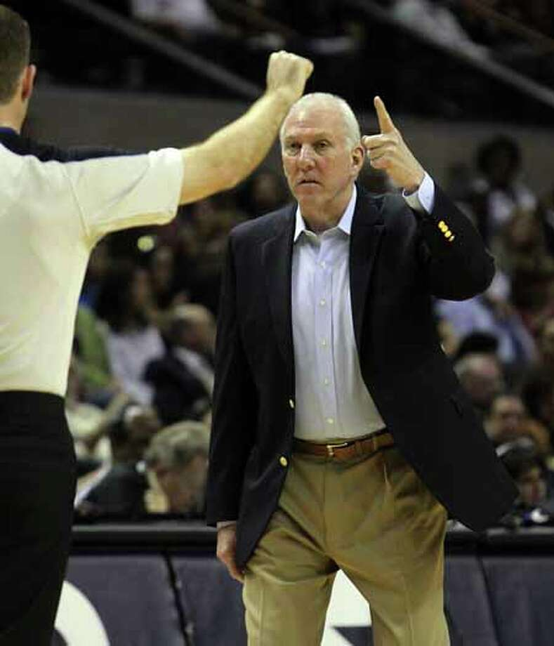 Spurs coach Gregg Popovich points out a call to a game official during their game against the Charlotte Bobcats at the AT&T Center on Friday, Mar. 2, 2012. Kin Man Hui/San Antonio Express-News Photo: Kin Man Hui, San Antonio Express-News / © 2012 San Antonio Express-News