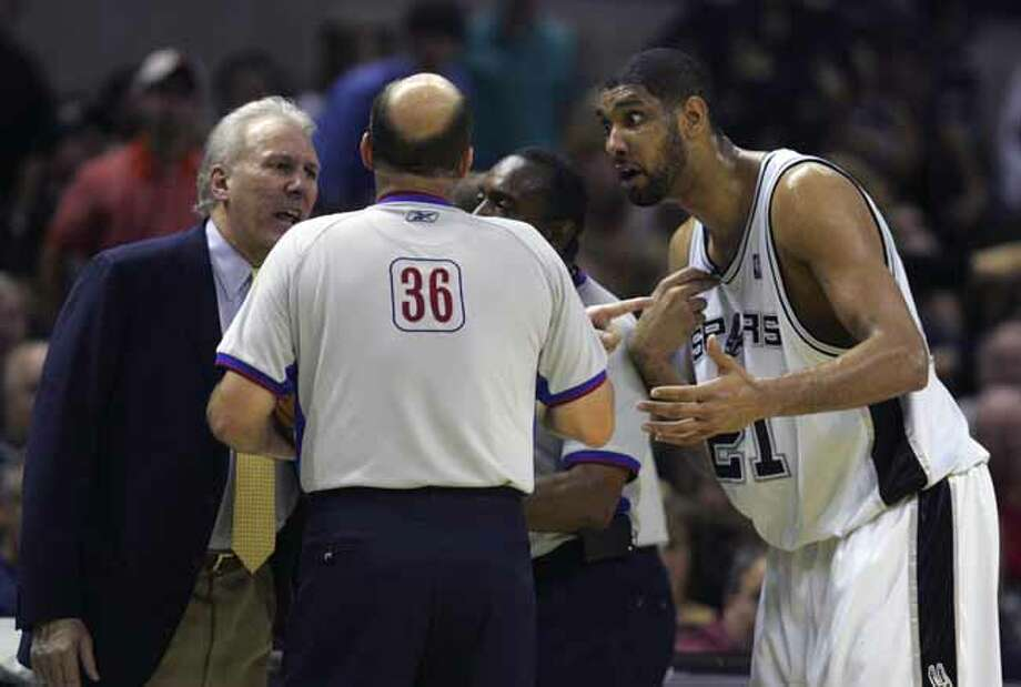 SPORTS   --- The Spurs' Gregg Popovich, left, and Tim Duncan talk Tuesday night May 9, 2006 at the AT&T Center  to the officials about a call during the second game of their Western Conference Semi-Finals match-up against the Dallas Mavericks.         (BAHRAM MARK SOBHANI/STAFF) (Bahram Mark Sobhani / Express-News file photo) Photo: BAHRAM MARK SOBHANI, SAN ANTONIO EXPRESS NEWS / SAN ANTONIO EXPRESS NEWS