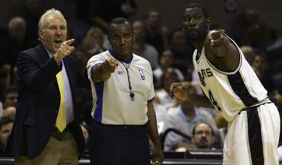 SPORTS   ---  Coach Gregg Popovich and Michael Finley argue with ref Eddie Rush in the fourth quarter Tuesday night May 9, 2006 at the AT&T Center during the second game of their Western Conference Semi-Finals match-up. The Spurs lost 91-113.       (BAHRAM MARK SOBHANI/STAFF) (Bahram Mark Sobhani / Express-News file photo) Photo: BAHRAM MARK SOBHANI, SAN ANTONIO EXPRESS NEWS / SAN ANTONIO EXPRESS NEWS