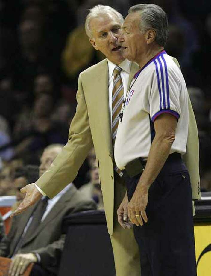 San Antonio Spurs Head Coach Gregg Popovich discusses a call with referee Jack Nies during the second half of game one of the first round against the Denver Nuggets at the at&t Center on Sunday, April 22, 2007. ( JERRY LARA STAFF ) Photo: JERRY LARA, SAN ANTONIO EXPRESS-NEWS / SAN ANTONIO EXPRESS-NEWS