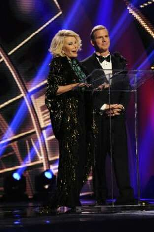AMERICA'S GOT TALENT -- Episode 731 -- Pictured: (l-r) Joan Rivers, Tom Cotter -- (Photo by: Virginia Sherwood/NBC) (NBC / Virginia Sherwood/NBC)