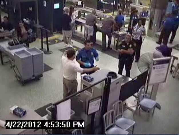 In a video frame grab taken from security camera footage, U.S. Rep. Francisco Quico Canseco is seen talking to security officials at the San Antonio International Airport TSA checkpoint during an April 22, 2012 trip Cancesco took through the airport in which he was singled out for a secondary search of his carry-on items and a pat-down of his body. After two security-line skirmishes involving Transportation Security Administration pat downs, officers labeled U.S. Rep. Quico Canseco was labeled an Òunruly passengerÓÑ a label he rejects. The Republican congressman from the 23rd district says the federal agency has been given too much power. TSA officials maintain he was subjected to the same security standards as any other passenger. Photo: COURTESY OF SAN ANTONIO AIRPORT / PHOTO COURTESY OF SAN ANOTNIO AIRPORT TSA