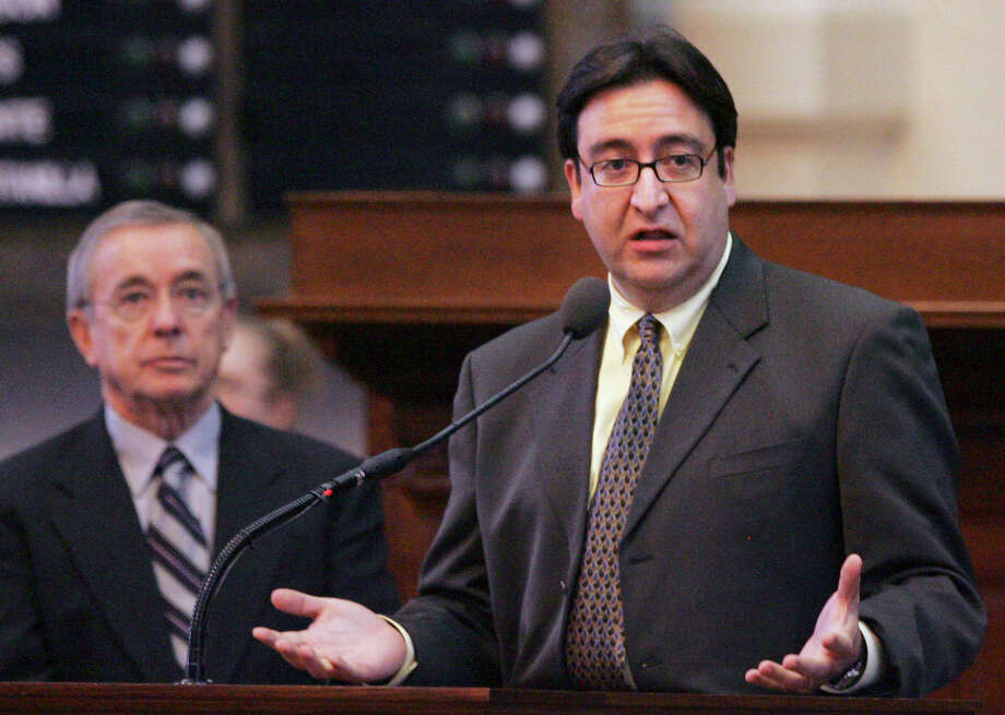 State Rep. Pete Gallego, D-Alpine, right speaks on the floor of the Texas House of Representatives as Rep. Warren Chisum, R- Pampa, looks on  in Austin, Texas, Tuesday, Feb. 20, 2007.  The Texas House adopted a resolution Tuesday that would allow them to exceed the state's spending limit by billions for the first time since constraints were added to the state constitution in 1978. Photo: LM Otero, AP / AP