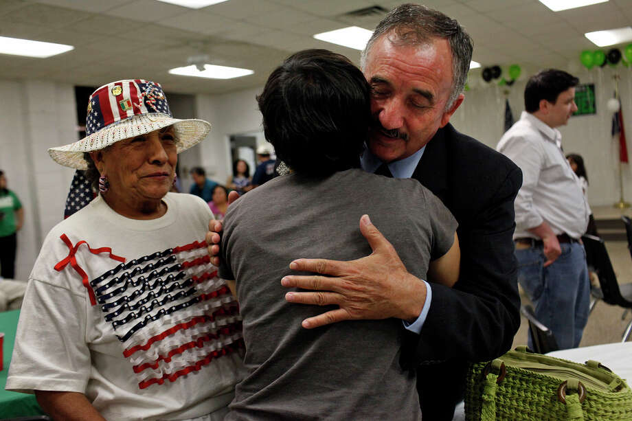 Ciro Rodriguez embraces Chrystal Rodriguez as he greets supporters including Luisa Vargas, left, who he went to high school with, upon his arrival at the Harlandale Civic Center where supporters gathered to watch the results come in from his runoff against Pete Gallego on Tuesday, July 31, 2012. Gallego defeated Rodriguez for the Democratic nomination. Photo: Lisa Krantz, San Antonio Express-News / San Antonio Express-News