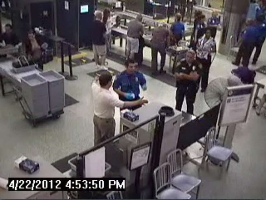 "In a video frame grab taken from security camera footage, U.S. Rep. Francisco ""Quico"" Canseco is seen talking to security officials at the San Antonio International Airport TSA checkpoint during an April 22, 2012 trip Cancesco took through the airport in which he was singled out for a secondary search of his carry-on items and a pat-down of his body. After two security-line skirmishes involving Transportation Security Administration pat downs, officers labeled U.S. Rep. Quico Canseco was labeled an Òunruly passengerÓÑ a label he rejects. The Republican congressman from the 23rd district says the federal agency has been given too much power. TSA officials maintain he was subjected to the same security standards as any other passenger. (COURTESY OF SAN ANTONIO AIRPORT)"