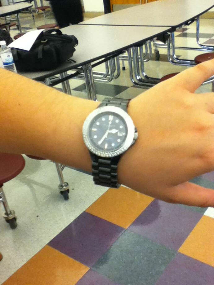 A student at Mohonasen shows off her watch. Photo by Andrew Pugliese. Photo: New Visions: Journalism & Media Studies