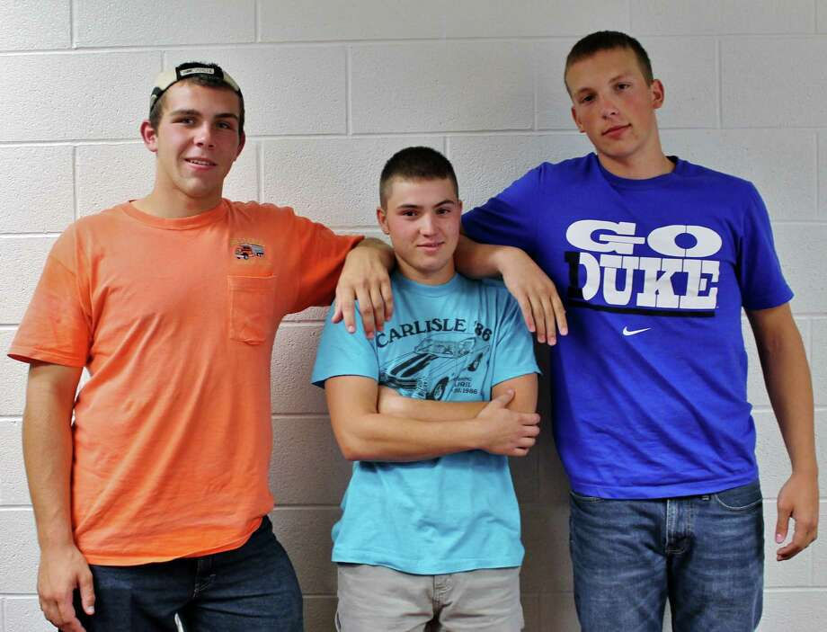 A simple T-shirt never goes out of style, as shown by Seniors Joe Sprung, Anthony Pasquini, and Garrett Pitcher. Photo by Alex Luciano. Photo: New Visions: Journalism & Media Studies
